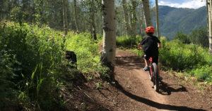 Family mopuntan bike riding in Snowmass, Colorado